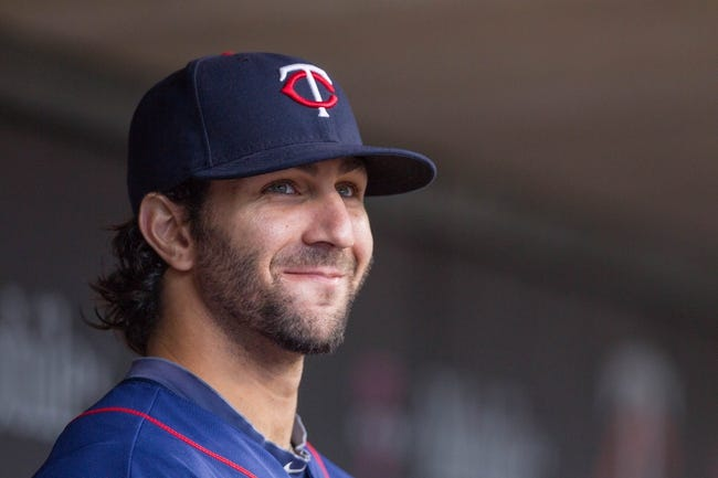 Sep 15, 2013; Minneapolis, MN, USA; The Minnesota Twins outfielder Darin Mastroianni (19) sits in the dugout before the game against the Tampa Bay Rays at Target Field. Twins win 6-4. Mandatory Credit: Brad Rempel-USA TODAY Sports