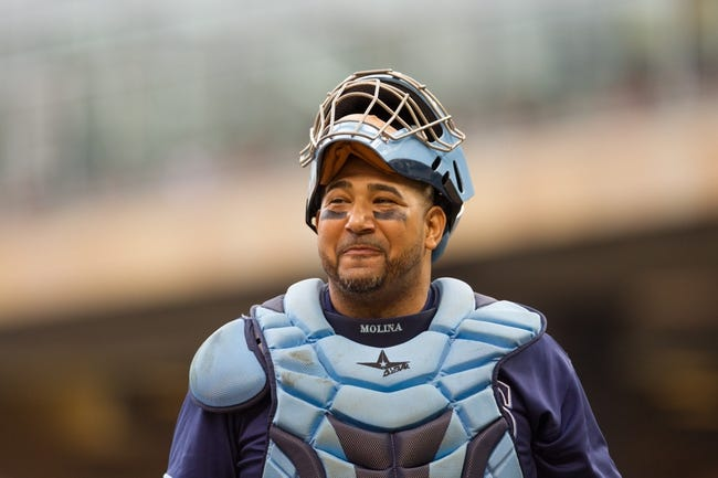 Sep 15, 2013; Minneapolis, MN, USA; The Tampa Bay Rays catcher Jose Molina (28) walks back to the dugout at the end of the fourth inning against the Minnesota Twins at Target Field. Twins win 6-4. Mandatory Credit: Brad Rempel-USA TODAY Sports