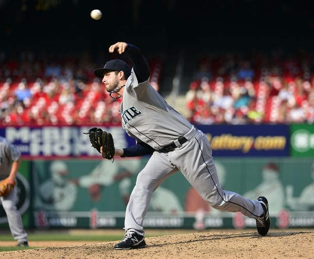 Sep 15, 2013; St. Louis, MO, USA; Seattle Mariners relief pitcher Lucas Luetge (44) delivers a pitch against the St. Louis Cardinals at Busch Stadium. The Cardinals defeated the Mariners 12-2. Mandatory Credit: Scott Rovak-USA TODAY Sports