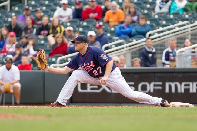 Sep 15, 2013; Minneapolis, MN, USA; The Minnesota Twins outfielder Chris Parmelee (27) reaches to catch the ball for the out in the ninth inning against the Tampa Bay Rays at Target Field.Twins win 6-4. Mandatory Credit: Brad Rempel-USA TODAY Sports