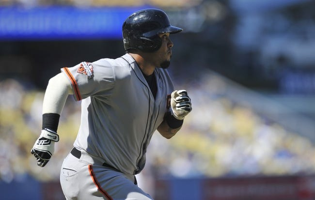 September 15, 2013; Los Angeles, CA, USA; San Francisco Giants catcher Hector Sanchez (29) runs after hitting a single during the fifth inning against the Los Angeles Dodgers at Dodger Stadium. Mandatory Credit: Gary A. Vasquez-USA TODAY Sports