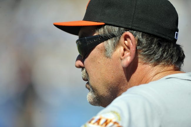 September 15, 2013; Los Angeles, CA, USA; San Francisco Giants manager Bruce Bochy (15) watches game action during the fifth inning against the Los Angeles Dodgers at Dodger Stadium. Mandatory Credit: Gary A. Vasquez-USA TODAY Sports