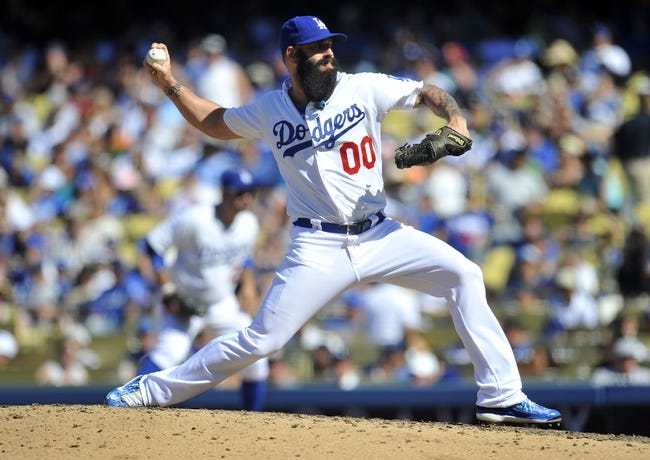 September 15, 2013; Los Angeles, CA, USA; Los Angeles Dodgers relief pitcher Brian Wilson (00) pitches during the seventh inning against the San Francisco Giants at Dodger Stadium. Mandatory Credit: Gary A. Vasquez-USA TODAY Sports