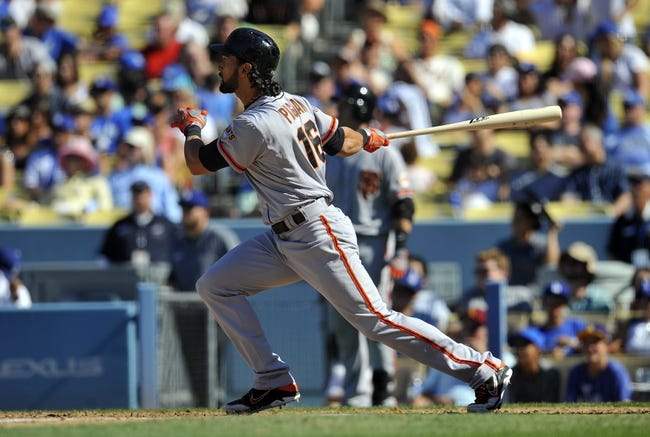 September 15, 2013; Los Angeles, CA, USA; San Francisco Giants center fielder Angel Pagan (16) hits into a fielders choice in the seventh inning against the Los Angeles Dodgers at Dodger Stadium. Mandatory Credit: Gary A. Vasquez-USA TODAY Sports