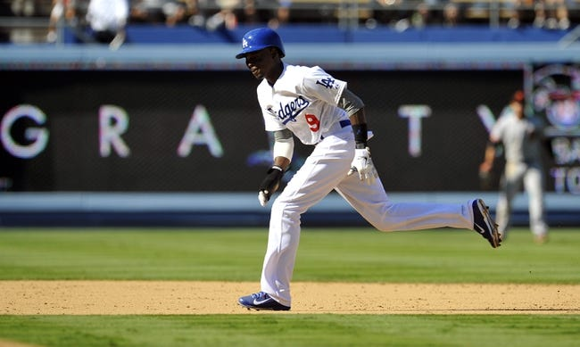 September 15, 2013; Los Angeles, CA, USA; Los Angeles Dodgers shortstop Dee Gordon (9) runs to third in the seventh inning against the San Francisco Giants at Dodger Stadium. Mandatory Credit: Gary A. Vasquez-USA TODAY Sports
