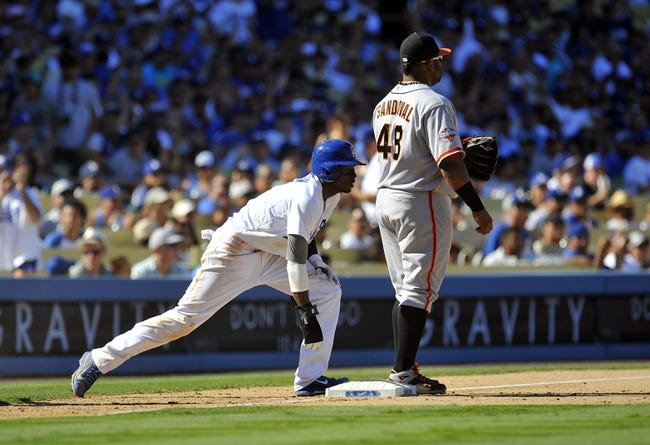 September 15, 2013; Los Angeles, CA, USA; Los Angeles Dodgers shortstop Dee Gordon (9) reaches third safely in the seventh inning against the San Francisco Giants at Dodger Stadium. Mandatory Credit: Gary A. Vasquez-USA TODAY Sports