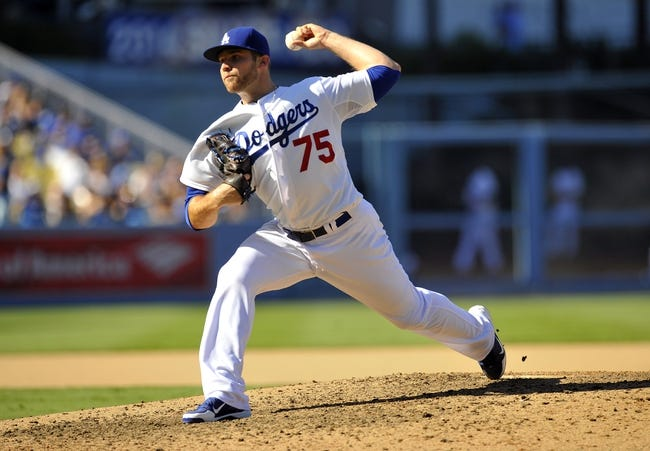September 15, 2013; Los Angeles, CA, USA; Los Angeles Dodgers relief pitcher Paco Rodriguez (75) pitches during the seventh inning against the San Francisco Giants at Dodger Stadium. Mandatory Credit: Gary A. Vasquez-USA TODAY Sports