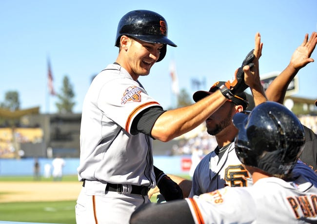 September 15, 2013; Los Angeles, CA, USA; San Francisco Giants first baseman Brett Pill (6) is congratulated after hitting a solo home run in the seventh inning against the Los Angeles Dodgers at Dodger Stadium. Mandatory Credit: Gary A. Vasquez-USA TODAY Sports