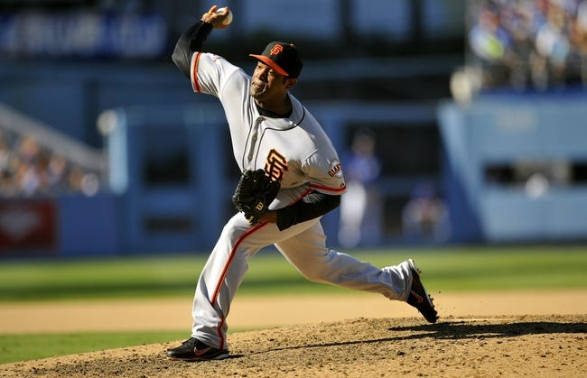 September 15, 2013; Los Angeles, CA, USA; San Francisco Giants relief pitcher Santiago Casilla (46) pitches during the eighth inning against the Los Angeles Dodgers at Dodger Stadium. Mandatory Credit: Gary A. Vasquez-USA TODAY Sports