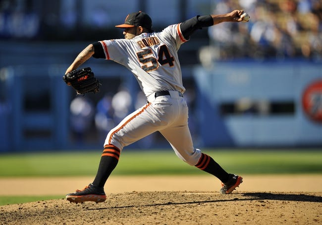September 15, 2013; Los Angeles, CA, USA; San Francisco Giants relief pitcher Sergio Romo (54) pitches during the ninth inning against the Los Angeles Dodgers at Dodger Stadium. Mandatory Credit: Gary A. Vasquez-USA TODAY Sports