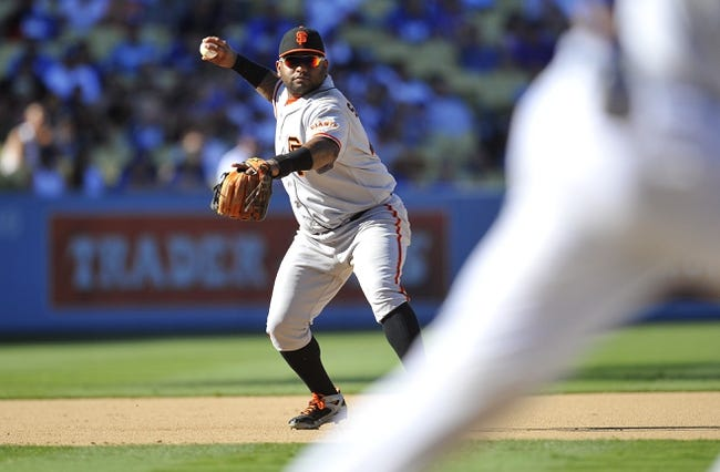 September 15, 2013; Los Angeles, CA, USA; San Francisco Giants third baseman Pablo Sandoval (48) throws to first to complete an out in the eighth inning against the Los Angeles Dodgers at Dodger Stadium. Mandatory Credit: Gary A. Vasquez-USA TODAY Sports