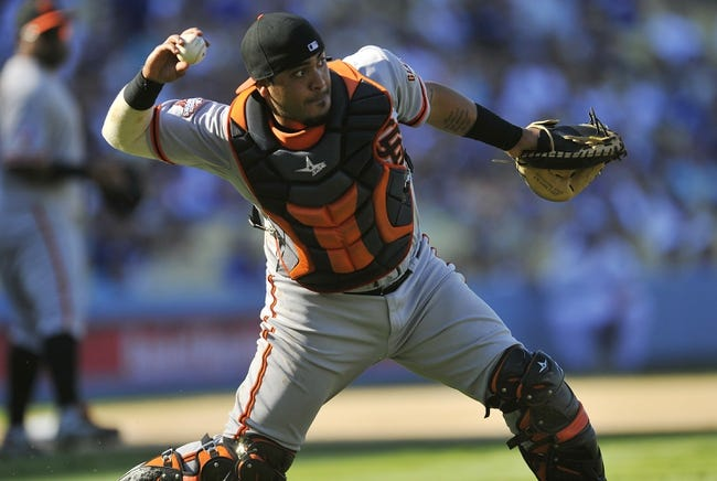 September 15, 2013; Los Angeles, CA, USA; San Francisco Giants catcher Hector Sanchez (29) throws to first to complete an out in the ninth inning against the Los Angeles Dodgers at Dodger Stadium. Mandatory Credit: Gary A. Vasquez-USA TODAY Sports