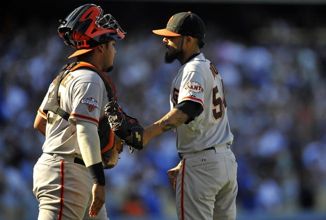 September 15, 2013; Los Angeles, CA, USA; San Francisco Giants relief pitcher Sergio Romo (54) and catcher Hector Sanchez (29) celebrate the 4-3 victory against the Los Angeles Dodgers at Dodger Stadium. Mandatory Credit: Gary A. Vasquez-USA TODAY Sports