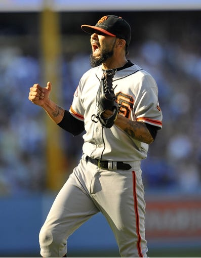 September 15, 2013; Los Angeles, CA, USA; San Francisco Giants relief pitcher Sergio Romo (54) reacts following the 4-3 victory against the Los Angeles Dodgers at Dodger Stadium. Mandatory Credit: Gary A. Vasquez-USA TODAY Sports