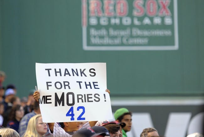 Sep 15, 2013; Boston, MA, USA; A fan holds a sign in honor of New York Yankees relief pitcher Mariano Rivera (not pictured) prior to a game against the Boston Red Sox at Fenway Park. Mandatory Credit: Bob DeChiara-USA TODAY Sports