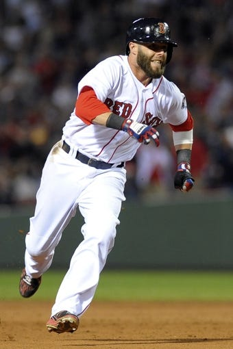 Sep 15, 2013; Boston, MA, USA; Boston Red Sox first baseman Mike Napoli (12) runs to third base during the fifth inning against the New York Yankees at Fenway Park. Mandatory Credit: Bob DeChiara-USA TODAY Sports