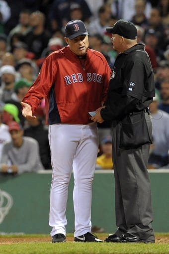 Sep 15, 2013; Boston, MA, USA; Boston Red Sox manager John Farrell (left) argues with home plate umpire Ron Kulpa (46) during the sixth inning against the New York Yankees at Fenway Park. Mandatory Credit: Bob DeChiara-USA TODAY Sports
