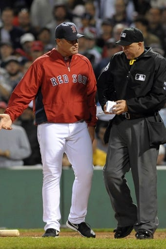 Sep 15, 2013; Boston, MA, USA; Boston Red Sox manager John Farrell (53) argues with home plate umpire Ron Kulpa (46) during the sixth inning against the New York Yankees at Fenway Park. Mandatory Credit: Bob DeChiara-USA TODAY Sports