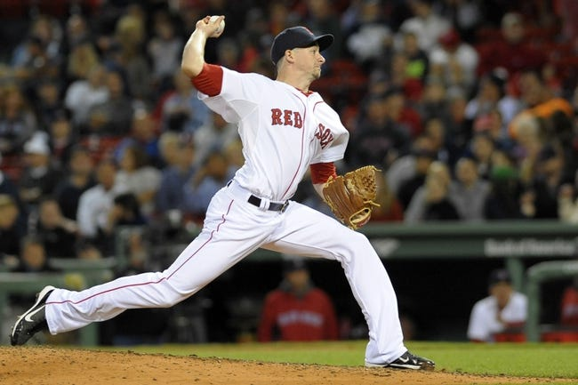 Sep 15, 2013; Boston, MA, USA; Boston Red Sox relief pitcher Allen Webster (64) pitches during the ninth inning against the New York Yankees at Fenway Park. Mandatory Credit: Bob DeChiara-USA TODAY Sports