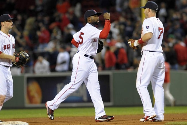Sep 15, 2013; Boston, MA, USA; Boston Red Sox left fielder Jackie Bradley Jr. (25) congratulates shortstop Stephen Drew (7) after defeating the New York Yankees at Fenway Park. Mandatory Credit: Bob DeChiara-USA TODAY Sports