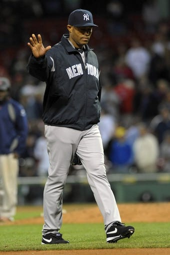 Sep 15, 2013; Boston, MA, USA; New York Yankees relief pitcher Mariano Rivera (42) walks to the dugout after the game against the Boston Red Sox at Fenway Park. Mandatory Credit: Bob DeChiara-USA TODAY Sports
