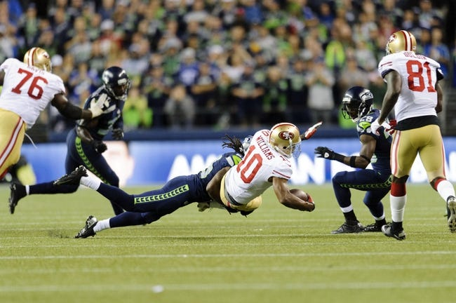 Sep 15, 2013; Seattle, WA, USA; Seattle Seahawks cornerback Richard Sherman (25) tackles San Francisco 49ers wide receiver Kyle Williams (10) during the 2nd half at CenturyLink Field. Seattle defeated San Francisco 29-3. Mandatory Credit: Steven Bisig-USA TODAY Sports