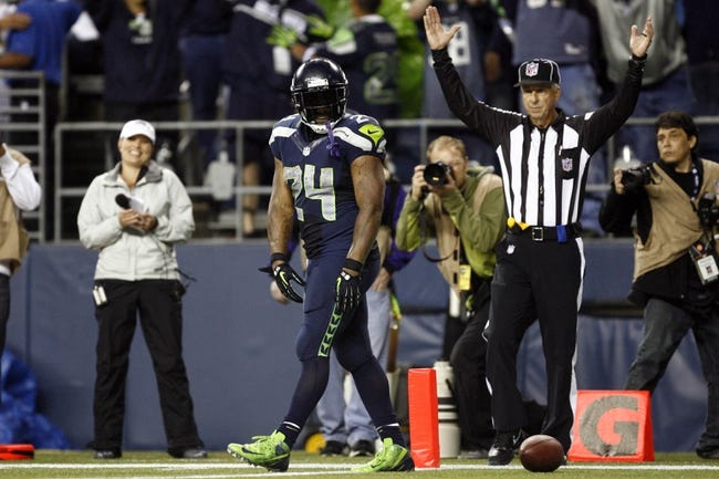 Sep 15, 2013; Seattle, WA, USA; Seattle Seahawks running back Marshawn Lynch (24) after scoring a touchdown against the San Francisco 49ers during the fourth quarter at CenturyLink Field. Mandatory Credit: Joe Nicholson-USA TODAY Sports
