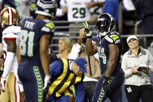 Sep 15, 2013; Seattle, WA, USA; Seattle Seahawks running back Marshawn Lynch (24) celebrates after rushing for a touchdown against the San Francisco 49ers during the fourth quarter at CenturyLink Field. Mandatory Credit: Joe Nicholson-USA TODAY Sports