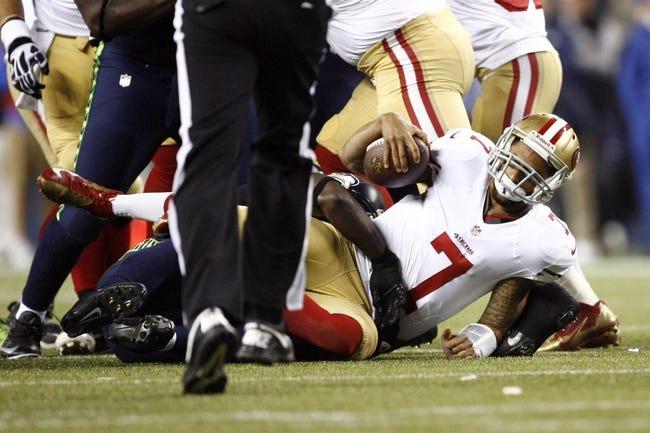 Sep 15, 2013; Seattle, WA, USA; San Francisco 49ers quarterback Colin Kaepernick (7) is sacked by the Seattle Seahawks during the fourth quarter at CenturyLink Field. Mandatory Credit: Joe Nicholson-USA TODAY Sports