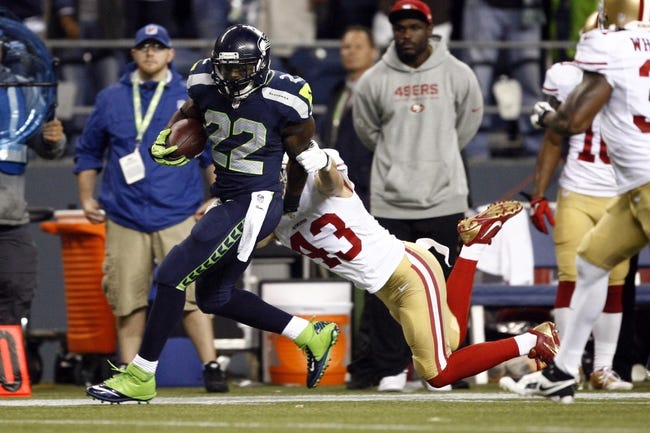 Sep 15, 2013; Seattle, WA, USA; Seattle Seahawks running back Robert Turbin (22) is pushed out of bounds by San Francisco 49ers strong safety Craig Dahl (43) during the second quarter at CenturyLink Field. Mandatory Credit: Joe Nicholson-USA TODAY Sports