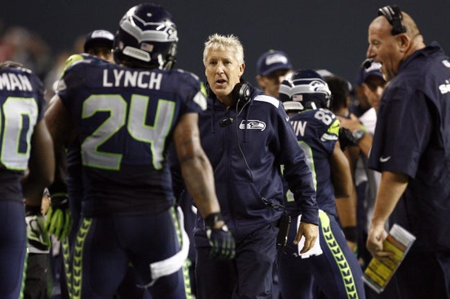 Sep 15, 2013; Seattle, WA, USA; Seattle Seahawks head coach Pete Carroll greets running back Marshawn Lynch (24) after Lynch rushed for a touchdown against the San Francisco 49ers during the third quarter at CenturyLink Field. Mandatory Credit: Joe Nicholson-USA TODAY Sports