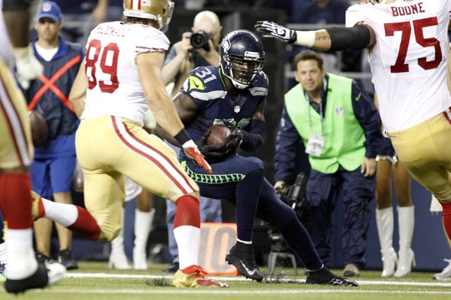 Sep 15, 2013; Seattle, WA, USA; Seattle Seahawks strong safety Kam Chancellor (31) returns an interception against the San Francisco 49ers during the fourth quarter at CenturyLink Field. Mandatory Credit: Joe Nicholson-USA TODAY Sports