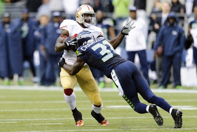 Sep 15, 2013; Seattle, WA, USA; Seattle Seahawks strong safety Kam Chancellor (31) tackles San Francisco 49ers tight end Vernon Davis (85) during the 1st half at CenturyLink Field. Seattle defeated San Francisco 29-3. Mandatory Credit: Steven Bisig-USA TODAY Sports