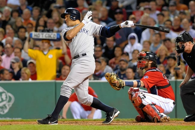 Sep 13, 2013; Boston, MA, USA; New York Yankees third baseman Alex Rodriguez (13) bats during the sixth inning against the Boston Red Sox at Fenway Park. Mandatory Credit: Bob DeChiara-USA TODAY Sports