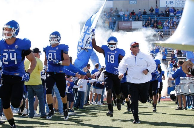 Sep 14, 2013; Buffalo, NY, USA; Buffalo Bulls wide receiver Fred Lee (18) and head coach Jeff Quinn head to the field for the game against the Stony Brook Seawolves at University of Buffalo Stadium. Buffalo beats Stony Brook 26-23 in OT. Mandatory Credit: Kevin Hoffman-USA TODAY Sports