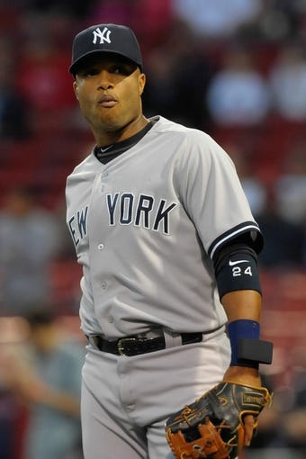 Sep 13, 2013; Boston, MA, USA; New York Yankees second baseman Robinson Cano (24) prior to the start of a game against the Boston Red Sox at Fenway Park. Mandatory Credit: Bob DeChiara-USA TODAY Sports