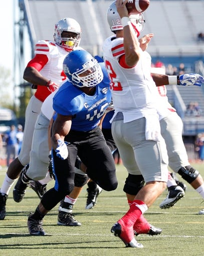 Sep 14, 2013; Buffalo, NY, USA; Buffalo Bulls linebacker Khalil Mack (46) rushes Stony Brook Seawolves quarterback Lyle Negron (12) during the game at University of Buffalo Stadium. Buffalo beats Stony Brook 26-23 in OT. Mandatory Credit: Kevin Hoffman-USA TODAY Sports