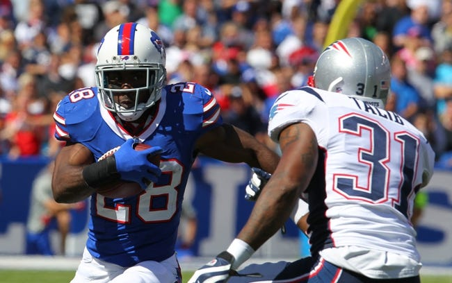 Sep 8, 2013; Orchard Park, NY, USA; Buffalo Bills running back C.J. Spiller (28) runs the ball during a game against the New England Patriots at Ralph Wilson Stadium.  Mandatory Credit: Timothy T. Ludwig-USA TODAY Sports