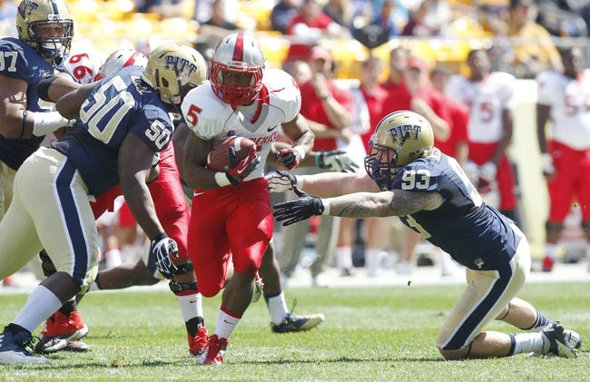 Sep 14, 2013; Pittsburgh, PA, USA; New Mexico Lobos running back Kasey Carrier (5) carries the ball against the Pittsburgh Panthers during the first quarter at Heinz Field. The Pittsburgh Panthers won 49-27. Mandatory Credit: Charles LeClaire-USA TODAY Sports
