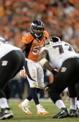 Sep 5, 2013; Denver, CO, USA; Denver Broncos outside linebacker Wesley Woodyard (52) at the line of scrimmage in the third quarter against the Baltimore Ravens at Sports Authority Field at Mile High. Mandatory Credit: Ron Chenoy-USA TODAY Sports