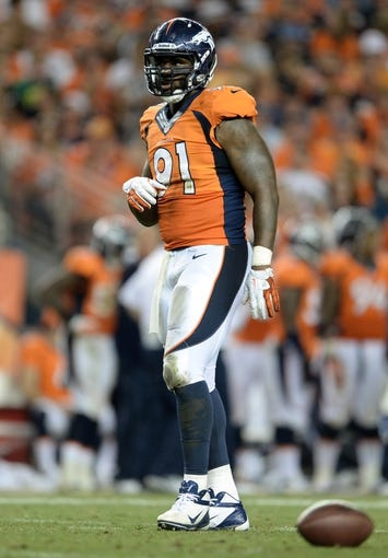 Sep 5, 2013; Denver, CO, USA; Denver Broncos defensive end Robert Ayers (91) during the game against the Baltimore Ravens at Sports Authority Field at Mile High. Mandatory Credit: Ron Chenoy-USA TODAY Sports