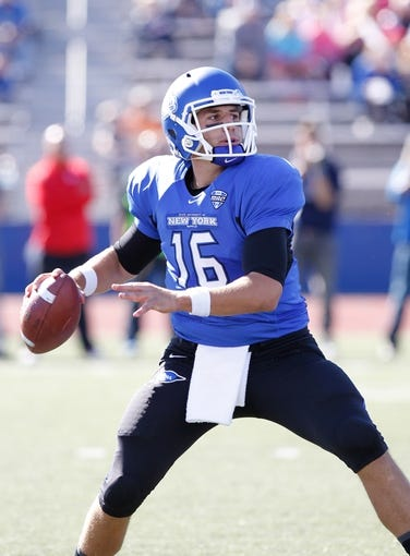 Sep 14, 2013; Buffalo, NY, USA; Buffalo Bulls quarterback Joe Licata (16) drops to pass against the Stony Brook Seawolves at University of Buffalo Stadium. Buffalo beats Stony Brook 26-23 in OT. Mandatory Credit: Kevin Hoffman-USA TODAY Sports