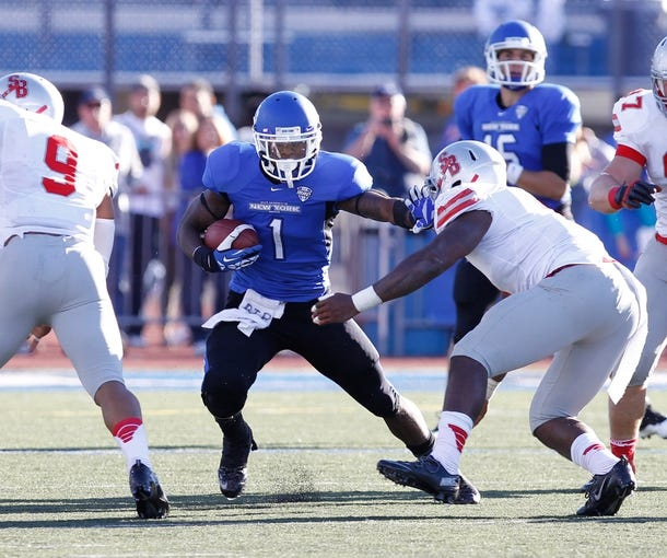 Sep 14, 2013; Buffalo, NY, USA; Buffalo Bulls running back James Potts (1) runs against the Stony Brook Seawolves during the game at University of Buffalo Stadium. Buffalo beats Stony Brook 26-23 in OT. Mandatory Credit: Kevin Hoffman-USA TODAY Sports
