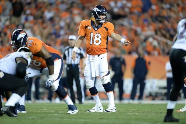 Sep 5, 2013; Denver, CO, USA; Denver Broncos quarterback Peyton Manning (18) calls out in the fourth quarter of the game against the Baltimore Ravens at Sports Authority Field at Mile High. Mandatory Credit: Ron Chenoy-USA TODAY Sports