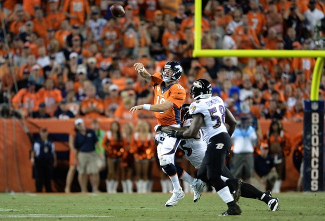 Sep 5, 2013; Denver, CO, USA; Denver Broncos quarterback Peyton Manning (18) releases the football as Baltimore Ravens outside linebacker Terrell Suggs (55) and linebacker Elvis Dumervil (58) defend at Sports Authority Field at Mile High. Mandatory Credit: Ron Chenoy-USA TODAY Sports