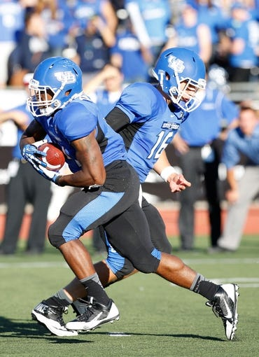 Sep 14, 2013; Buffalo, NY, USA; Buffalo Bulls quarterback Joe Licata (16) hands off to running back Anthone Taylor (14) during the game against the Stony Brook Seawolves at University of Buffalo Stadium. Buffalo beats Stony Brook 26-23 in OT. Mandatory Credit: Kevin Hoffman-USA TODAY Sports