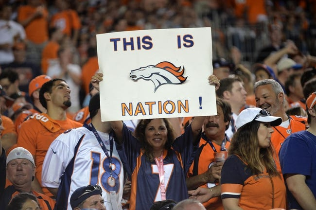 Sep 5, 2013; Denver, CO, USA; Denver Broncos fan holds a sign up during the first quarter against the Baltimore Ravens at Sports Authority Field at Mile High. Mandatory Credit: Ron Chenoy-USA TODAY Sports