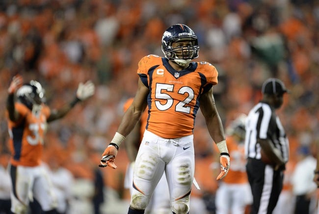 Sep 5, 2013; Denver, CO, USA; Denver Broncos outside linebacker Wesley Woodyard (52) reacts back to the crowd during the game against the Baltimore Ravens at Sports Authority Field at Mile High. Mandatory Credit: Ron Chenoy-USA TODAY Sports