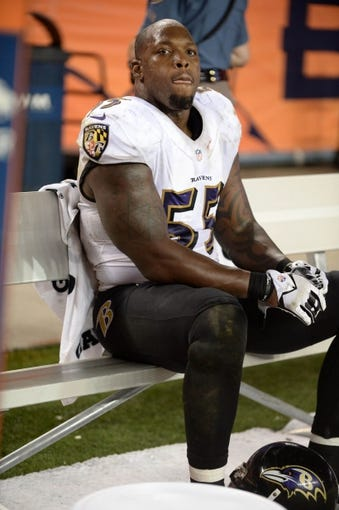 Sep 5, 2013; Denver, CO, USA; Baltimore Ravens outside linebacker Terrell Suggs (55) on the bench during the game against the Denver Broncos at Sports Authority Field at Mile High. Mandatory Credit: Ron Chenoy-USA TODAY Sports