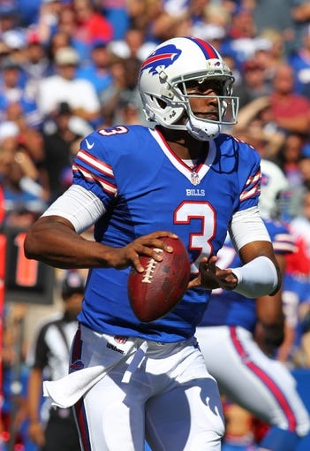 Sep 8, 2013; Orchard Park, NY, USA; Buffalo Bills quarterback EJ Manuel (3) looks to pass the ball against the New England Patriots at Ralph Wilson Stadium.  Patriots beat the Bills 23 to 21.  Mandatory Credit: Timothy T. Ludwig-USA TODAY Sports